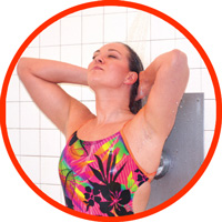 Swimmer rinsing pool water from hair