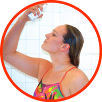 Swimmer applying SwimSpray Chlorine Removal